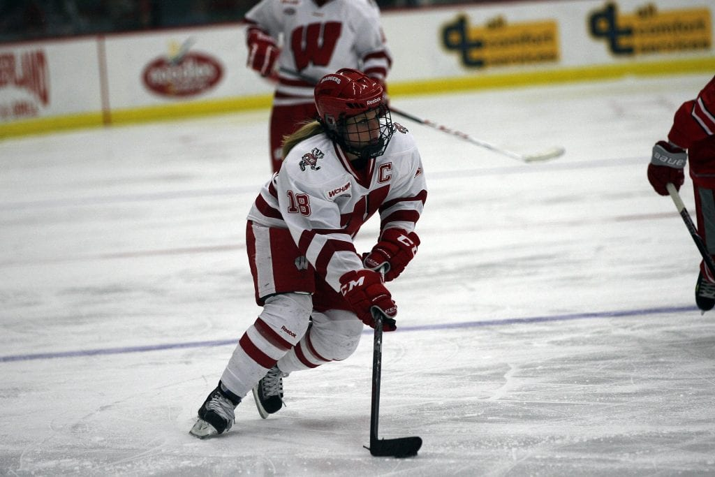 Brianna_Decker is a female athlete who dominates in hockey, seen here on the ice