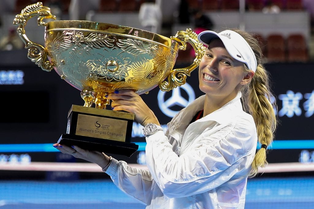 Caroline Wozniacki of Denmark hold the winner's trophy after winning the Women's Singles final against Anastasija Sevastova