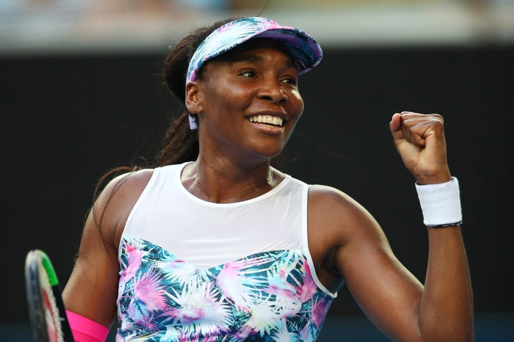 Venus Williams of the United States celebrates after winning match point in her first round match against Mihaela Buzarnescu of Romania