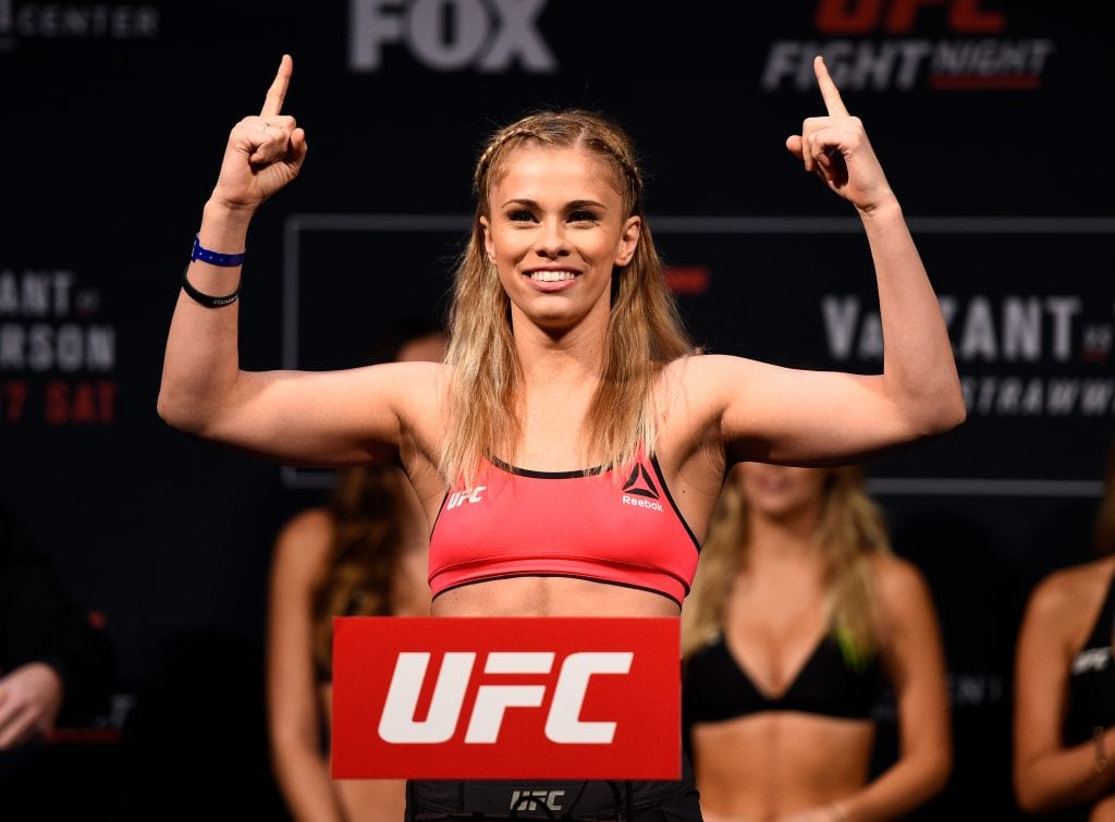 Paige VanZant poses on the scale during the UFC Fight Night weigh-in inside the Golden 1 Center Arena