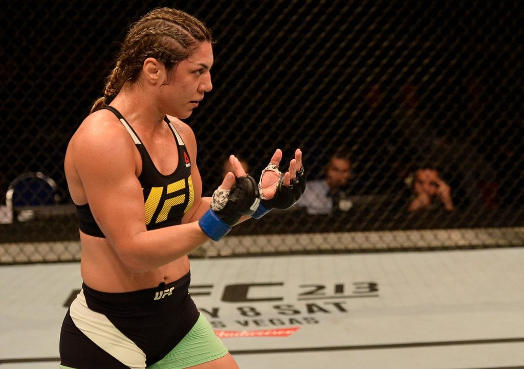 Bethe Correia of Brazil taunts Holly Holm (not pictured) in their women's bantamweight bout during the UFC Fight Night
