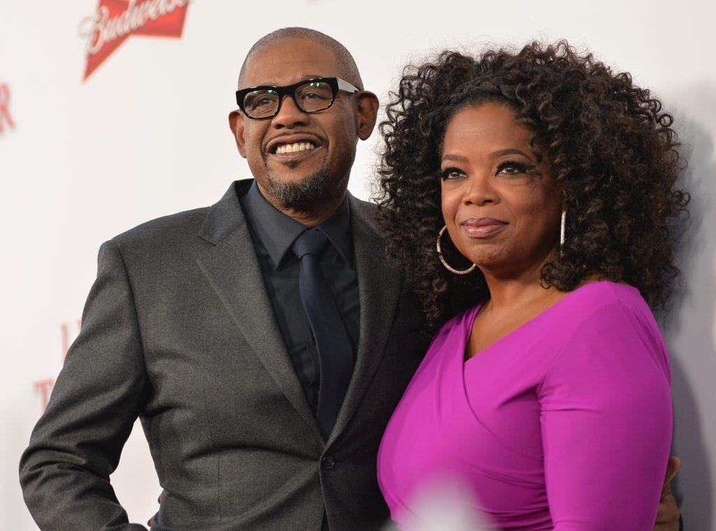 "Actor Forest Whitaker and Oprah Winfrey attend the Premiere Of The Weinstein Company's ""Lee Daniels' The Butler"" at Regal Cinemas L.A. Live on August 12, 2013 in Los Angeles, California. (Photo by Alberto E. Rodriguez/Getty Images)"