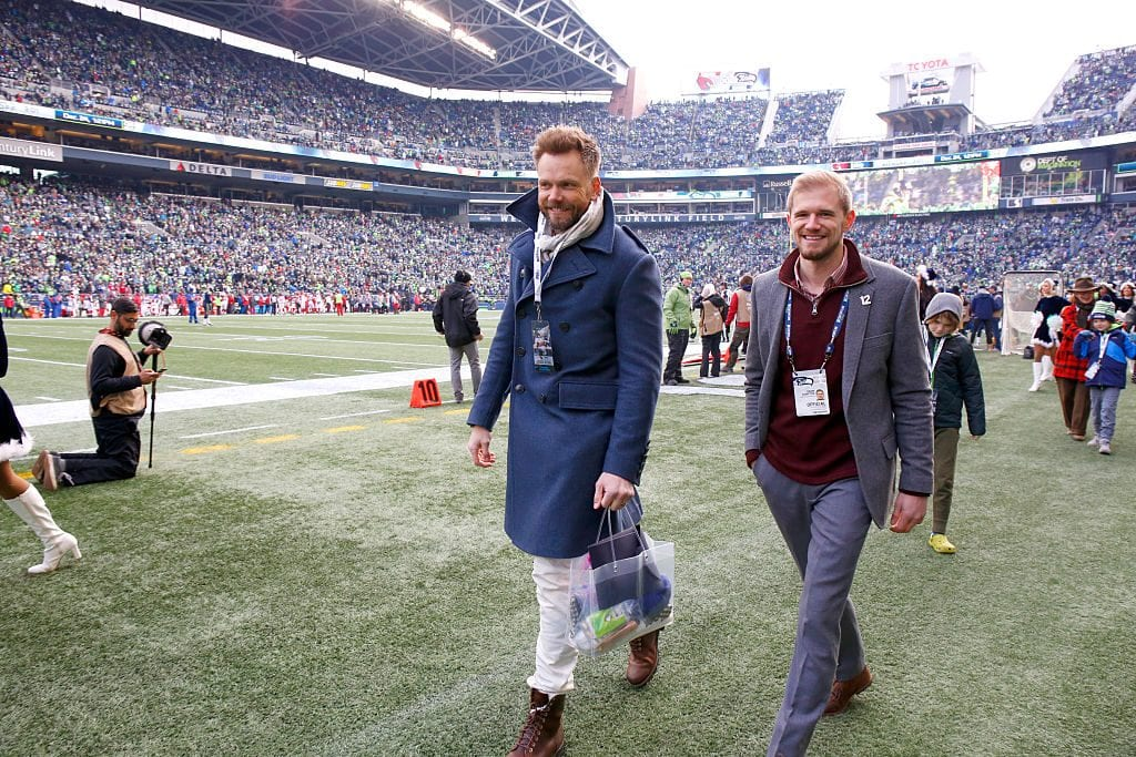 SEATTLE, WA - DECEMBER 24: Actor Joel McHale, left, attends an NFL game between the Seattle Seahawks and the Arizona Cardinals at CenturyLink Field on December 24, 2016 in Seattle, Washington. (Photo by Otto Greule Jr/Getty Images)
