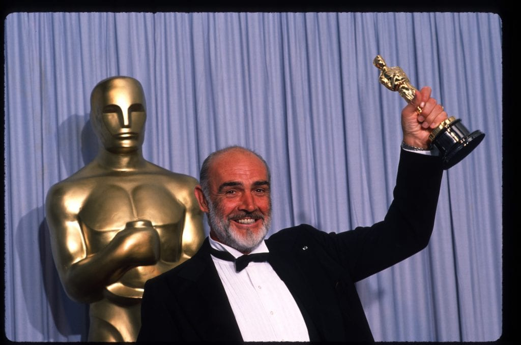 "Actor Sean Connery holds up his Best Actor in a Supporting Role Oscar for ""The Untouchables"" at the Academy Awards April 11, 1988 in Los Angeles, CA. The Academy Awards are prizes given out annually in Hollywood for excellence in film performance and production. (Photo by John Barr/Liaison)"
