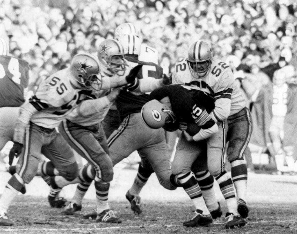 "Quarterback Bart Starr #15 of the Green Bay Packers is tackled by Dave Edwards #52 and Lee Roy Jordan #55 of the Dallas Cowboys during the 1967 NFL Championship Game on December 31, 1967 at Lambeau Field in Green Bay, Wisconsin. The game would be known as the ""Ice Bowl"""