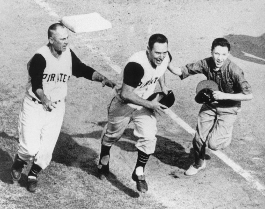 Bill Mazeroski #9 of the Pittsburgh Pirates celebrates as he runs home after hitting a walk off home run