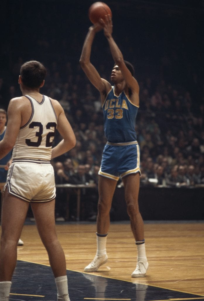 UCLA's Lew Alcindor #33 shoots a free throw during a NCAA game in 1968. (Photo by Focus on Sport via Getty Images)