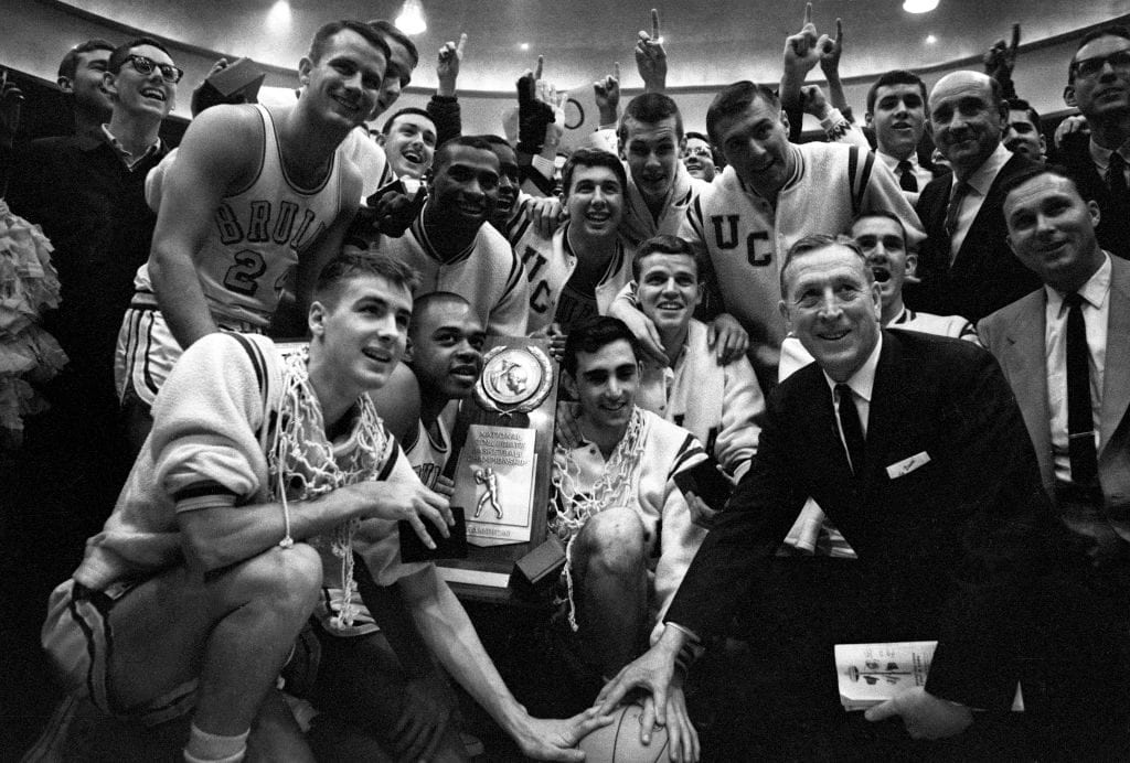 21 MAR 1964: John Wooden, coach of UCLA after winning the NCAA Photos via Getty Images Men's National Basketball Final Four championship game held in Kansas City, MO Municipal Auditorium. UCLA defeated Duke 98-83 for the title. .Photo: © Rich Clarkson / NCAA Photos via Getty Images Photos via Getty Images via Getty Images