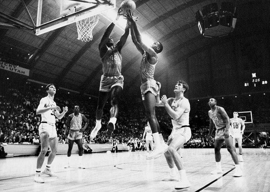 David Lattin (42) and a Texas Western teammate compete for control of a rebound as Kentucky's Tommy Kron, left, and Pat Riley , right, look on during the 1966 NCAA Photos via Getty Images Championship. Texas Western defeated Kentucky 72-65 for the championship title and was the first team to have an.. all-.black starting five compete in the NCAA