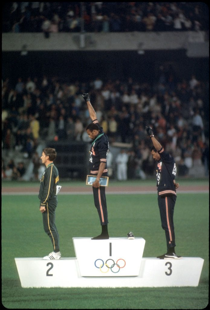 "12-27 OCT 1968: Tommy Smith (307) (1st place) and John Carlos (259) (3rd place) of the US raise their fists in the ""Black Power Salute"" during the playing of the national anthem at the Olympics in Mexico City, Mexico. Photo: © Rich Clarkson / Rich Clarkson & Associates"