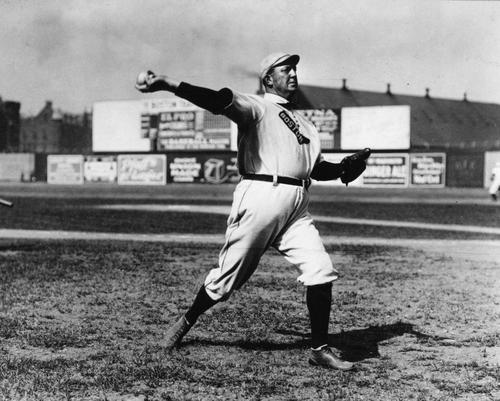 Cy Young, pitcher for the Boston Red Sox, warms up before a game at Huntingdon Ave. Grounds in Boston in 1908