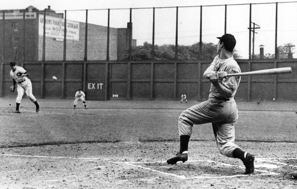 JULY 16, 1941. Joe DiMaggio drives a pitch up the middle to establish a new, and still standing, record, hitting in 56 straight games, in a game at Cleveland on July 16, 1941. (Photo by Mark Rucker/Transcendental Graphics, Getty Images)
