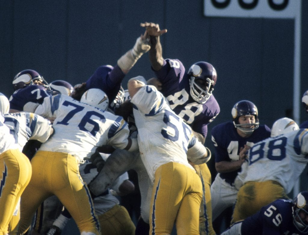 The Minnesota Vikings special teams, led by Hall of Fame member Alan Page (88), attempts to block an extra point against the San Diego Chargers during a 30-14 loss to the Chargers on December 5, 1971 at San Diego Stadium in San Diego, California.