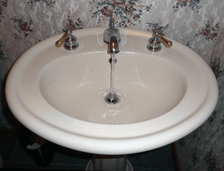 a clean-looking sink with the water running