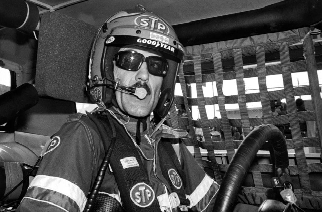 NASCAR driver Richard Petty sits in his racecar prior to the start of the 1983 Firecracker 400