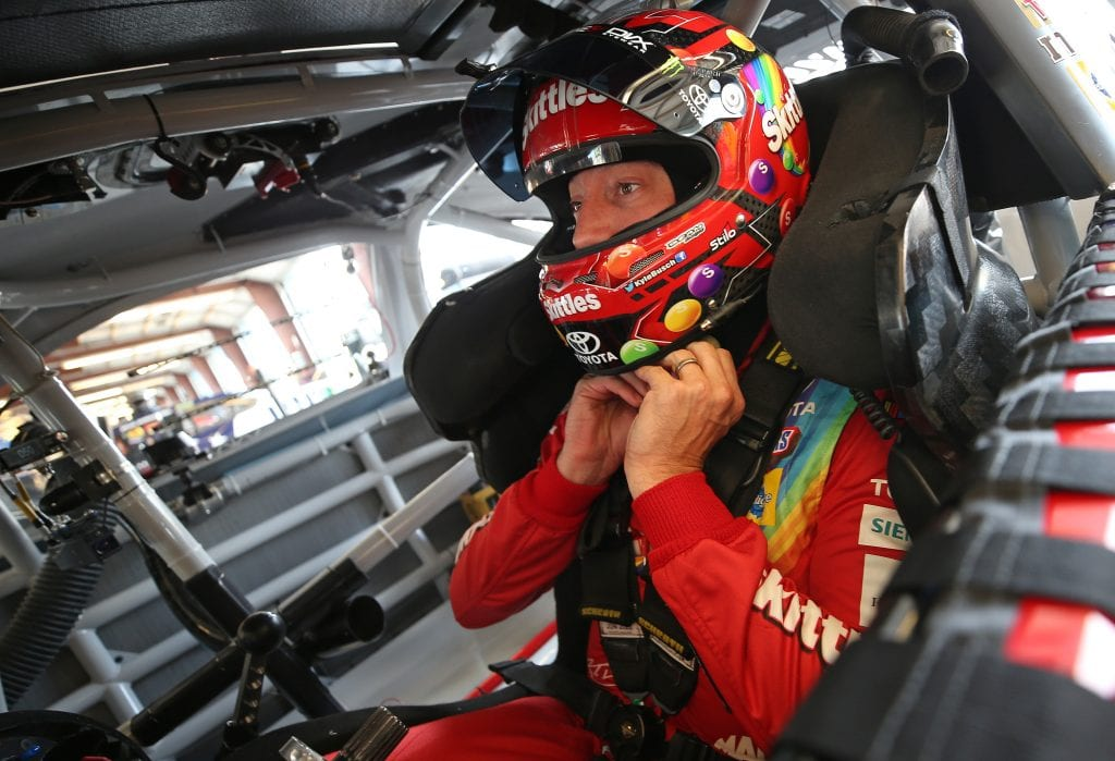Kyle Busch, driver of the #18 Skittles Red White & Blue Toyota, sits in his car during practice for the Monster Energy NASCAR Cup Series Camping World 400 at Chicagoland Speedway