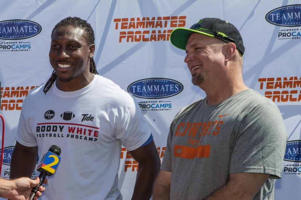 Roddy White and Garth Brooks are interviewed by local television during the Roddy White football ProCamp sponsored by Garth Brooks' and Troy Aikman's Teammates for Kids
