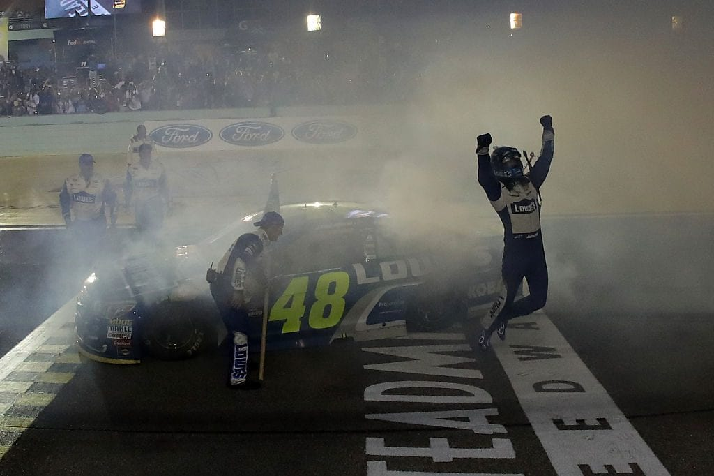 Jimmie Johnson, driver of the #48 Lowe's Chevrolet, celebrates after winning the NASCAR Sprint Cup Series Ford EcoBoost 400 and the 2016 NASCAR Sprint Cup Series Championship