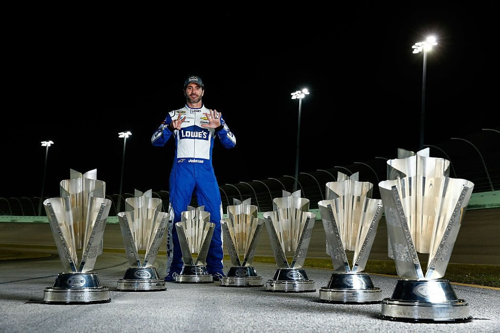 Jimmie Johnson, driver of the #48 Lowe's Chevrolet, poses for a portrait after winning the 2016 NASCAR Sprint Cup Series Championship at Homestead-Miami Speedway
