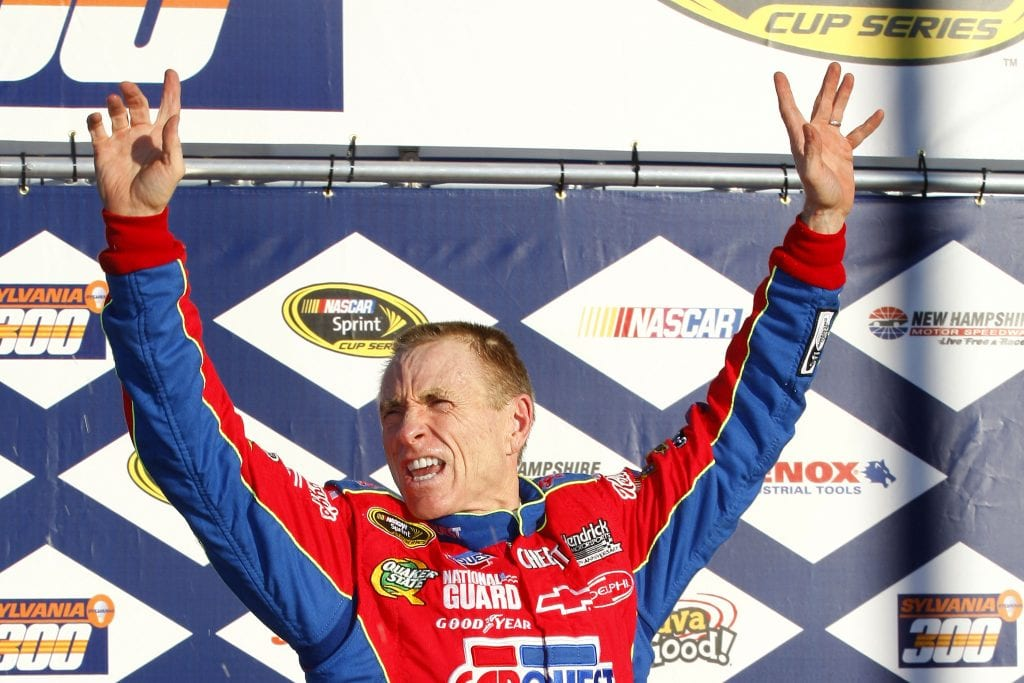 Mark Martin, driver of the #5 CARQUEST/Kellogg's Chevrolet, celebrates in victory lane after winnng the NASCAR Sprint Cup Series Sylvania 300
