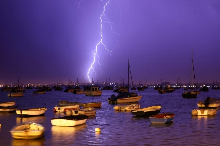 POOLE, ENGLAND - JULY 21: Lightning strikes over Poole Harbour during a thunderstorm on July 21, 2013 in Poole, England. The spell of hot weather was brought to an end last night on the South coast after a second week of heatwave conditions across the UK. (Photo by Dan Kitwood/Getty Images