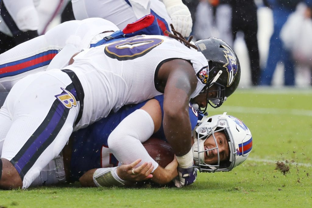 Quarterback Nathan Peterman #2 of the Buffalo Bills is tackled by Za'Darius Smith