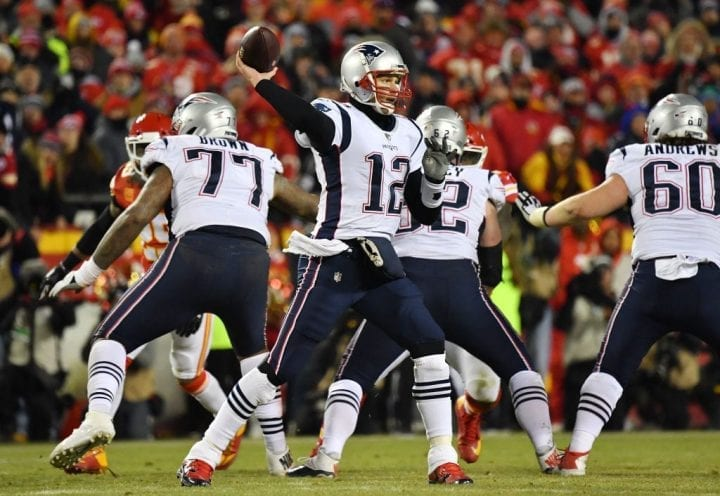 KANSAS CITY, MISSOURI - JANUARY 20: Tom Brady #12 of the New England Patriots passes in the second half against the Kansas City Chiefs during the AFC Championship Game at Arrowhead Stadium on January 20, 2019 in Kansas City, Missouri. (Photo by Peter Aiken/Getty Images)