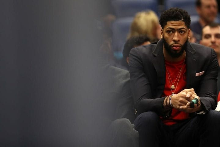 NEW ORLEANS, LOUISIANA - JANUARY 23: Anthony Davis #23 of the New Orleans Pelicans sits on the bench with an injury in his finger during the game against the Detroit Pistons at Smoothie King Center on January 23, 2019 in New Orleans, Louisiana. NOTE TO USER: User expressly acknowledges and agrees that, by downloading and or using this photograph, User is consenting to the terms and conditions of the Getty Images License Agreement. (Photo by Chris Graythen/Getty Images)
