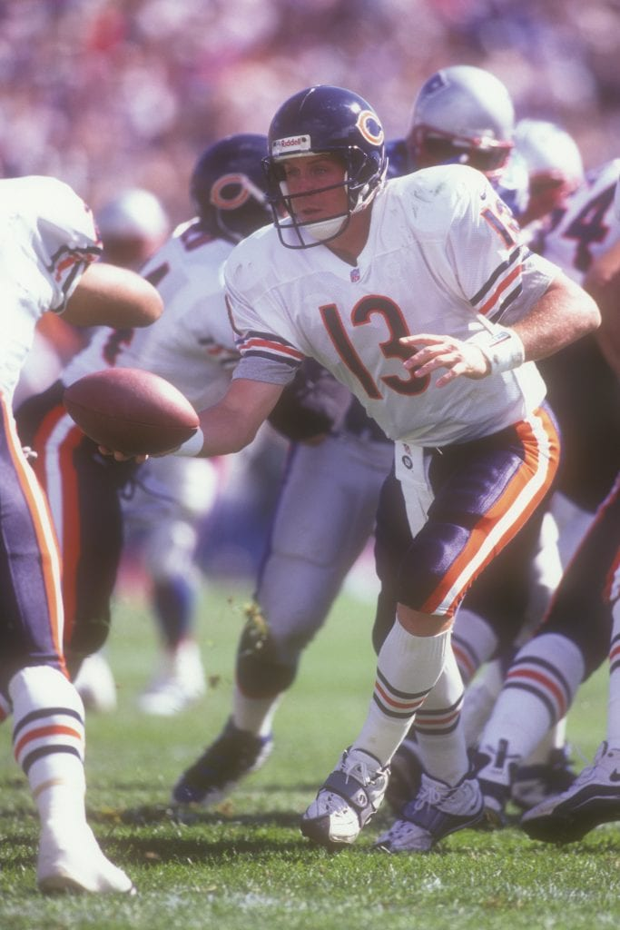 Rick Mirer #13 of the Chicago Bears hands off the ball during a football game against the New England Patriots