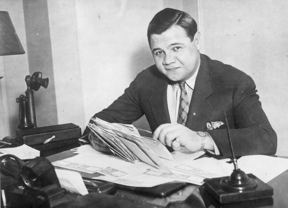 circa 1935: Babe Ruth (George Herman Ruth, 1895 - 1948) American professional baseball player signs a new two year contract with the 'New York Yankees'. (Photo by General Photographic Agency/Getty Images)