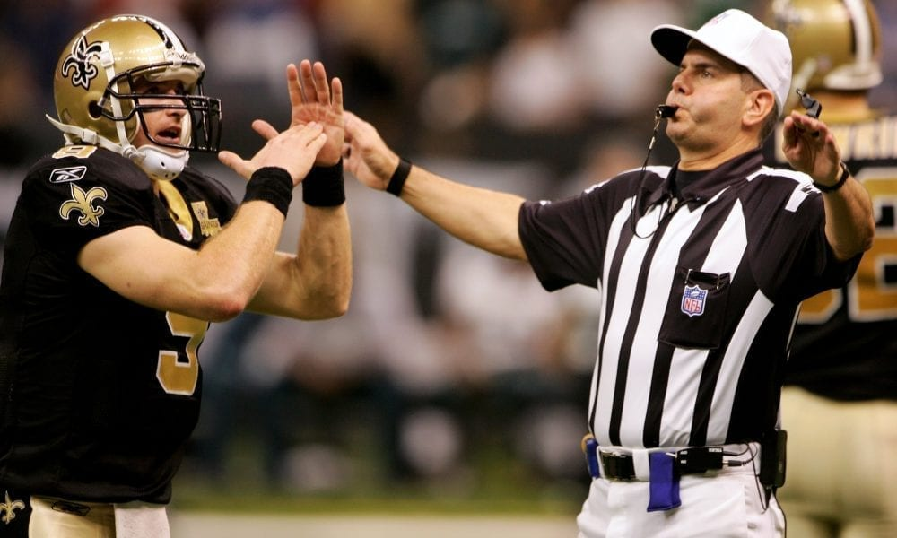 NEW ORLEANS - OCTOBER 15: Quarterback Drew Brees #9 of the New Orleans Saints calls a time out to referee Billy Vinovich with :03 seconds on the clock before kicker John Carney #3 entered the game to kick the winning 13 yard field goal with no time remaining against the Philadelphia Eagles October 15, 2006 at the Louisiana Superdome in New Orleans, Louisiana. The Saints defeated the Eagles 27-24. (Photo by Doug Pensinger/Getty Images)