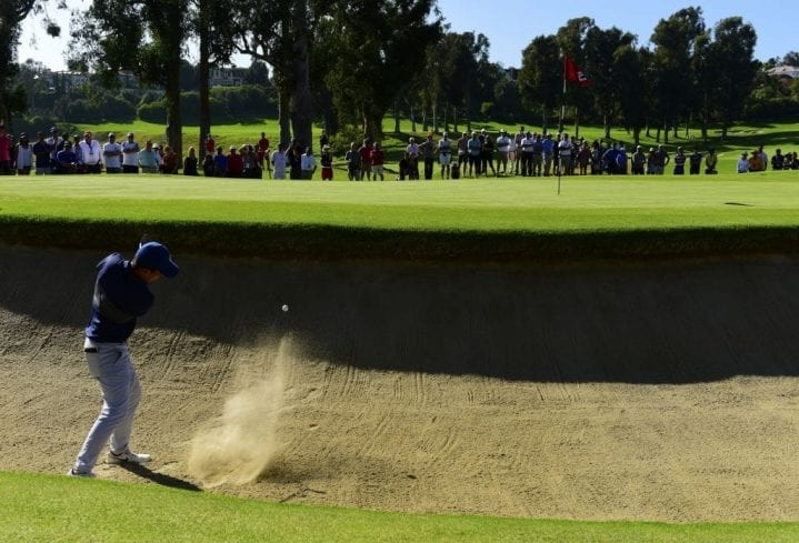 PACIFIC PALISADES, CA - AUGUST 20: Doug Ghim makes a shot out of a bunker on the 10th and extra hole during the second round of the USGA U.S. Amateur Championship 36 hole final on August 20, 2017 at the The Riviera Country Club in Pacific Palisades, California. (Photo by Robert Laberge/Getty Images)