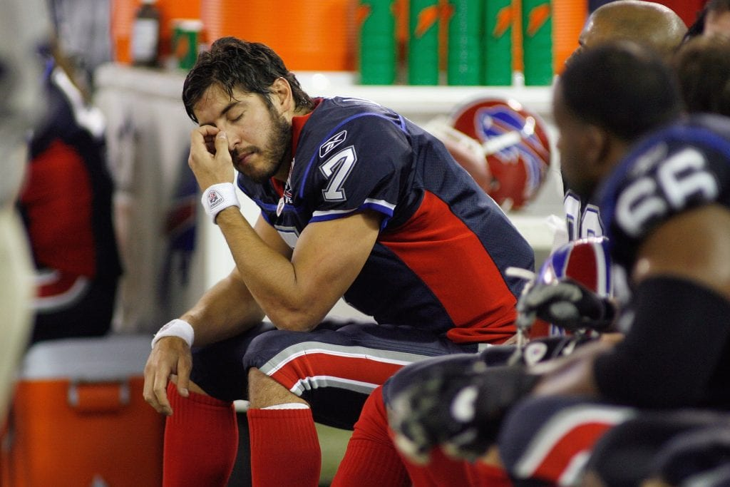 Quarterback J.P. Losman #7 of the Buffalo Bills sits on the bench during the game against the Miami Dolphins
