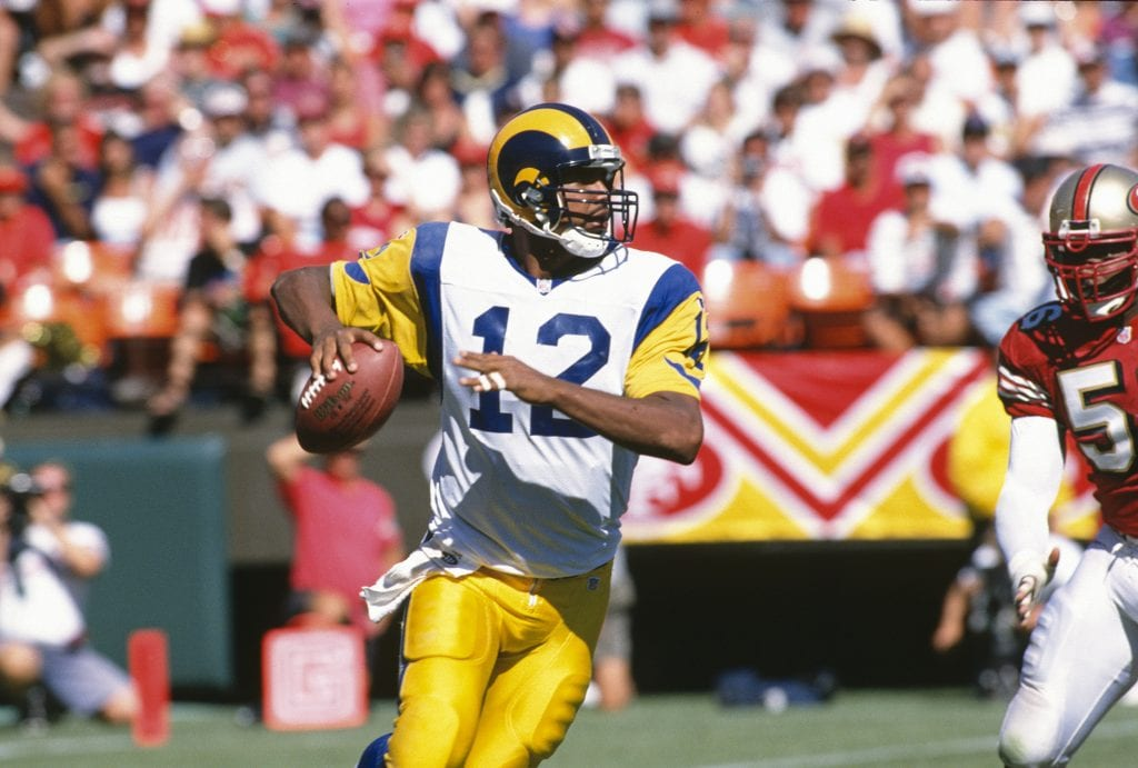 Tony Banks #12 of the St. Louis Rams looks to pass against the San Francisco 49ers