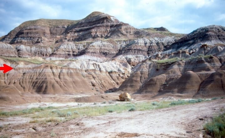 striations in rock of red, brown, and grey