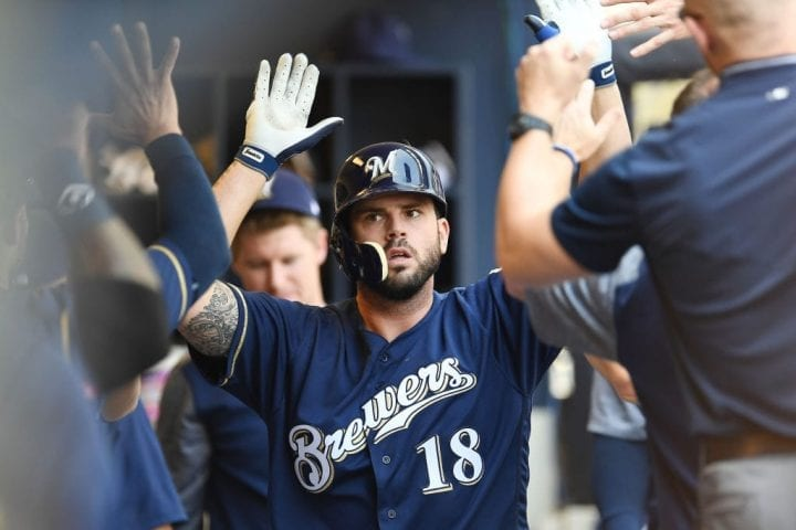 MILWAUKEE, WI - AUGUST 05: Mike Moustakas #18 of the Milwaukee Brewers is congratulated by teammates following a solo home run against the Colorado Rockies during the ninth inning of a game at Miller Park on August 5, 2018 in Milwaukee, Wisconsin. (Photo by Stacy Revere/Getty Images)