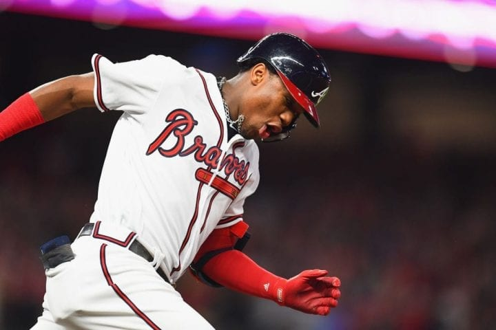 ATLANTA, GA - OCTOBER 07: Ronald Acuna Jr. #13 of the Atlanta Braves runs the bases after hitting a grand slam home run in the second inning against the Los Angeles Dodgers during Game Three of the National League Division Series at SunTrust Park on October 7, 2018 in Atlanta, Georgia. (Photo by Scott Cunningham/Getty Images)