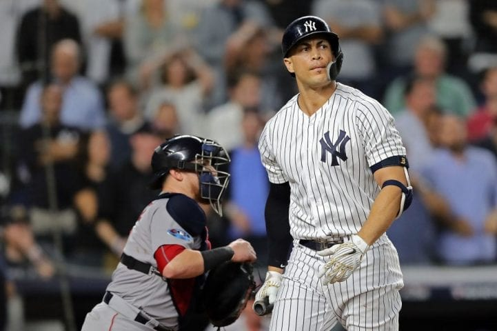 NEW YORK, NEW YORK - OCTOBER 09: Giancarlo Stanton #27 of the New York Yankees strikes out in the ninth inning against the Boston Red Sox during Game Four American League Division Series at Yankee Stadium on October 09, 2018 in the Bronx borough of New York City. (Photo by Elsa/Getty Images)