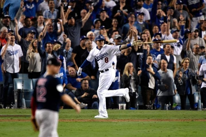 LOS ANGELES, CA - OCTOBER 26: Manny Machado #8 of the Los Angeles Dodgers hits a sixth inning single off the wall against the Boston Red Sox in Game Three of the 2018 World Series at Dodger Stadium on October 26, 2018 in Los Angeles, California. (Photo by Kevork Djansezian/Getty Images)