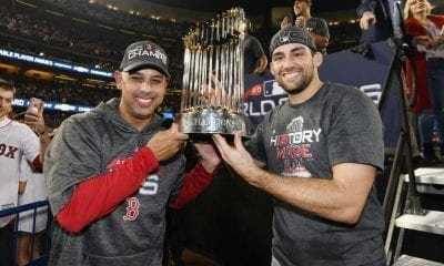 LOS ANGELES, CA - OCTOBER 28: Manager Alex Cora #20 and Nathan Eovaldi #17 of the Boston Red Sox celebrate with the World Series trophy after their teams 5-1 win over the Los Angeles Dodgers in Game Five of the 2018 World Series at Dodger Stadium on October 28, 2018 in Los Angeles, California. (Photo by Harry How/Getty Images)