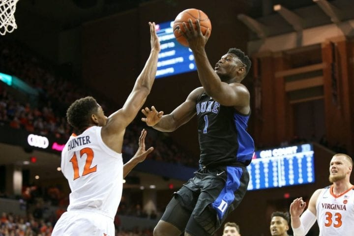 CHARLOTTESVILLE, VA - FEBRUARY 09: Zion Williamson #1 of the Duke Blue Devils shoots over De'Andre Hunter #12 of the Virginia Cavaliers in the first half during a game at John Paul Jones Arena on February 9, 2019 in Charlottesville, Virginia. (Photo by Ryan M. Kelly/Getty Images)