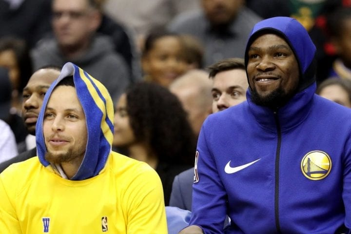 WASHINGTON, DC - JANUARY 24: Stephen Curry #30 and Kevin Durant #35 of the Golden State Warriors sit on the bench in the first half against the Washington Wizards at Capital One Arena on January 24, 2019 in Washington, DC. NOTE TO USER: User expressly acknowledges and agrees that, by downloading and or using this photograph, User is consenting to the terms and conditions of the Getty Images License Agreement. (Photo by Rob Carr/Getty Images)