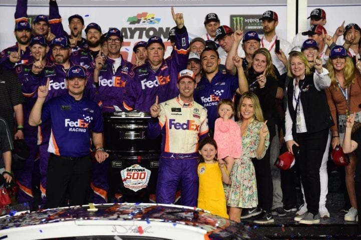 DAYTONA BEACH, FL - FEBRUARY 17: Denny Hamlin, driver of the #11 FedEx Express Toyota, celebrates in victory lane after winning the Monster Energy NASCAR Cup Series 61st Annual Daytona 500 at Daytona International Speedway on February 17, 2019 in Daytona Beach, Florida. (Photo by Jared C. Tilton/Getty Images)