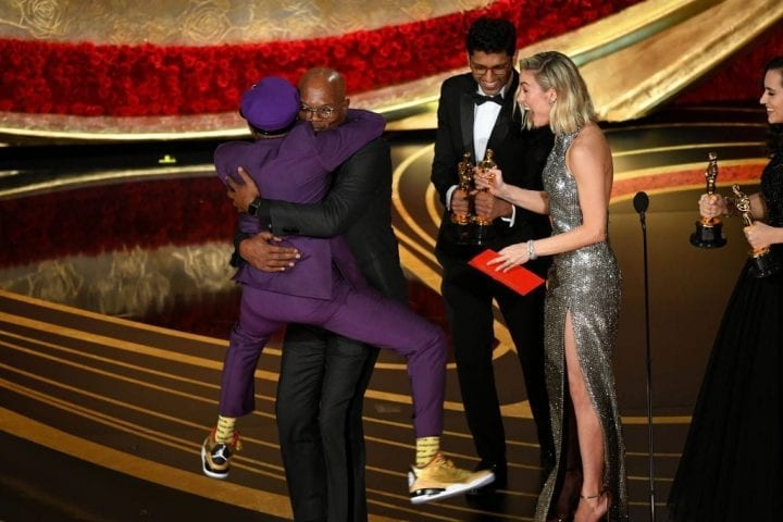 "HOLLYWOOD, CALIFORNIA - FEBRUARY 24: (L-R) Spike Lee accepts the Adapted Screenplay award for ""BlacKkKlansman"" from Samuel L. Jackson and Brie Larson onstage during the 91st Annual Academy Awards at Dolby Theatre on February 24, 2019 in Hollywood, California. (Photo by Kevin Winter/Getty Images)"