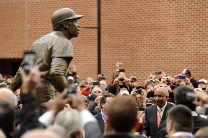 BALTIMORE, MD - APRIL 28: Former major league baseball player Frank Robinson watches the unveiling of his bronze sculpture before a baseball game between the Baltimore Orioles and Oakland Athletics at Oriole Park at Camden Yards on April 28, 2012 in Baltimore, Maryland. (Photo by Mitchell Layton/Getty Images)
