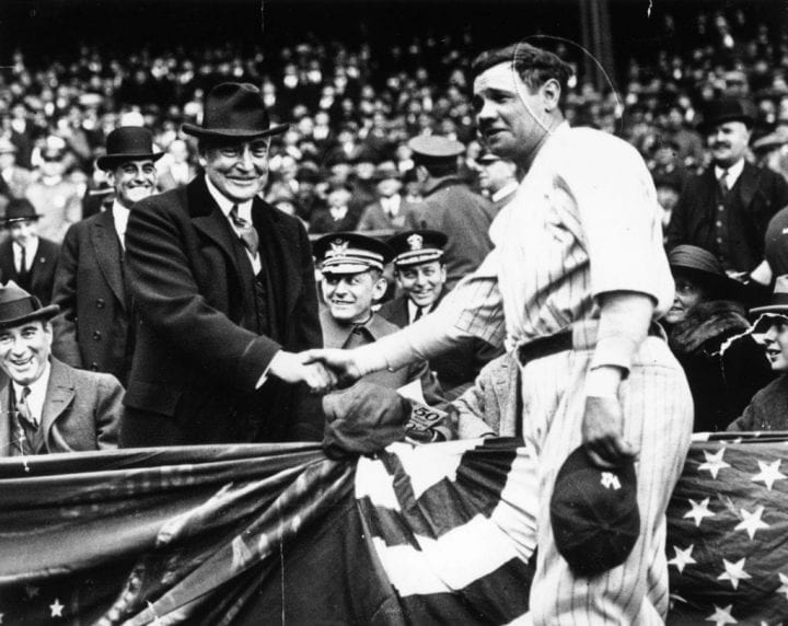 Great all-round baseball player, Babe Ruth (George Herman Ruth, 1895 - 1948) shakes hands with the 29th President of the USA, Warren Harding. After the handshake Babe Ruth hit a home run to help his team, the New York Yankees win the third game of the series with the Wash. (Photo by Keystone/Getty Images)