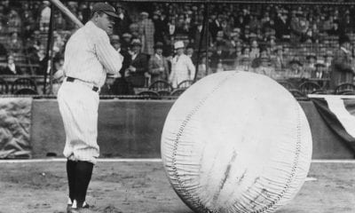 April 1927: Baseball player Babe Ruth (George Herman Ruth, 1895 - 1948) taking a swipe at an enormous ball. (Photo by Fox Photos/Getty Images)