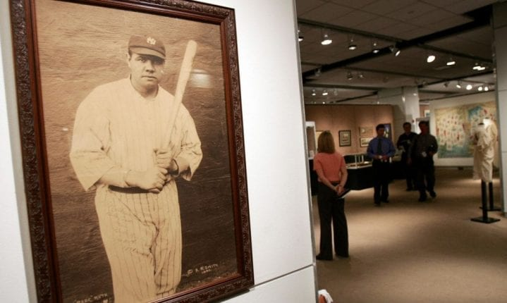"NEW YORK - NOVEMBER 23: A signed photograph of Babe Ruth is seen at a Sotheby's preview of a baseball memorabilia sale titled ""The Babe Comes Home"" November 23, 2004 in New York City. The sale will feature important historical baseball relics with items including the bat which Babe Ruth used to hit the first home run in Yankee Stadium. (Photo by Mario Tama/Getty Images)"