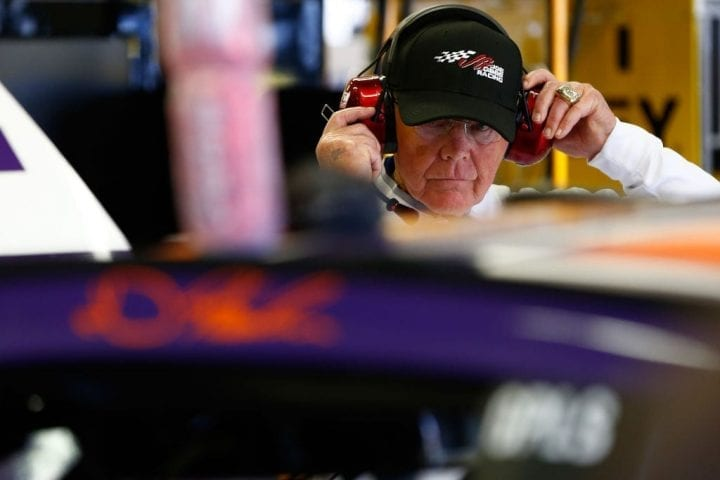 Joe Gibbs wearing a headset