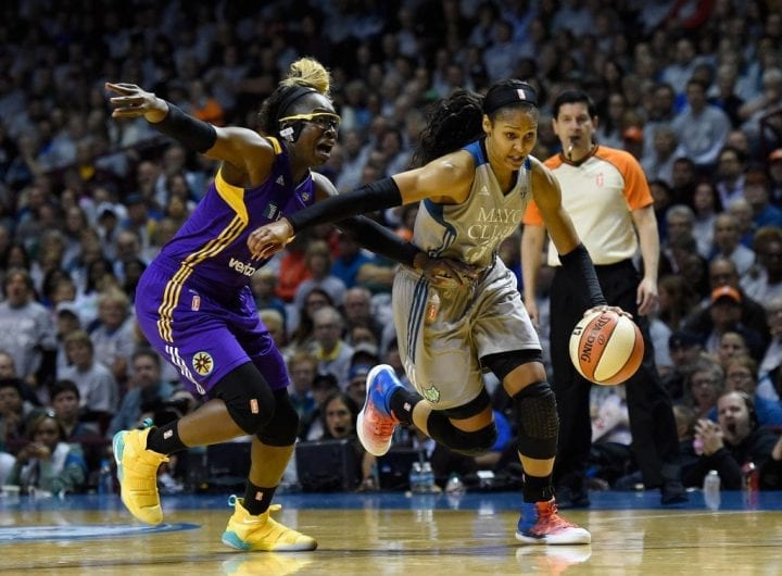 MINNEAPOLIS, MN - OCTOBER 04: Maya Moore #23 of the Minnesota Lynx drives to the basket against Essence Carson #17 of the Los Angeles Sparks during the second quarter of Game Five of the WNBA Finals on October 4, 2017 at Williams in Minneapolis, Minnesota. NOTE TO USER: User expressly acknowledges and agrees that, by downloading and or using this Photograph, user is consenting to the terms and conditions of the Getty Images License Agreement. (Photo by Hannah Foslien/Getty Images)